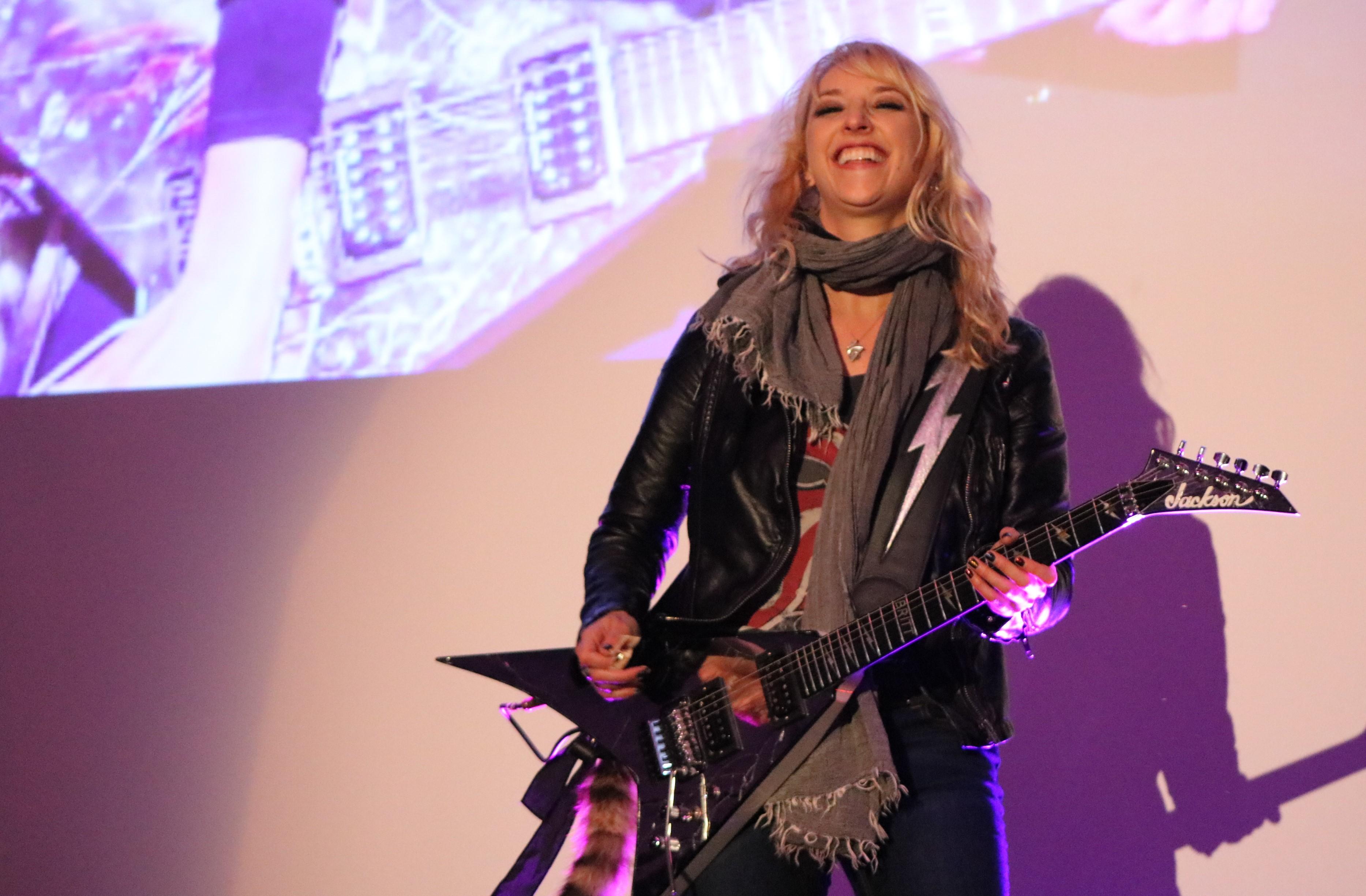 Britt Denaro performing at Austin Prep