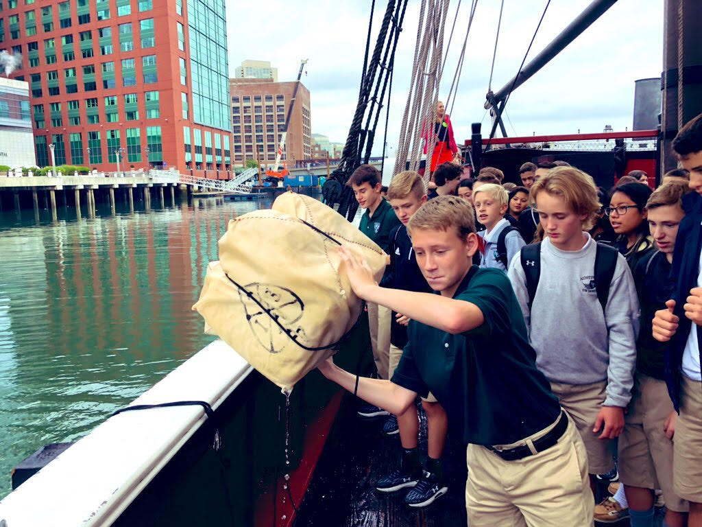 Students on a boat at the Boston Harbor